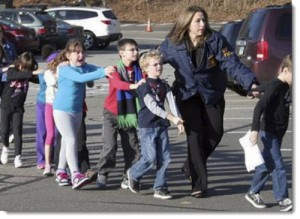 Authorities rush Sandy Hook Elementary students to safety on December 14, 2012. Photo Courtesy: Frugal Cafe